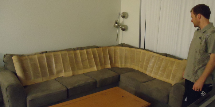 Torah scroll stretched out on couch
