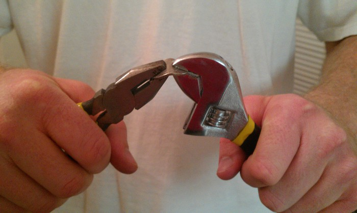 Bending coins with pliers